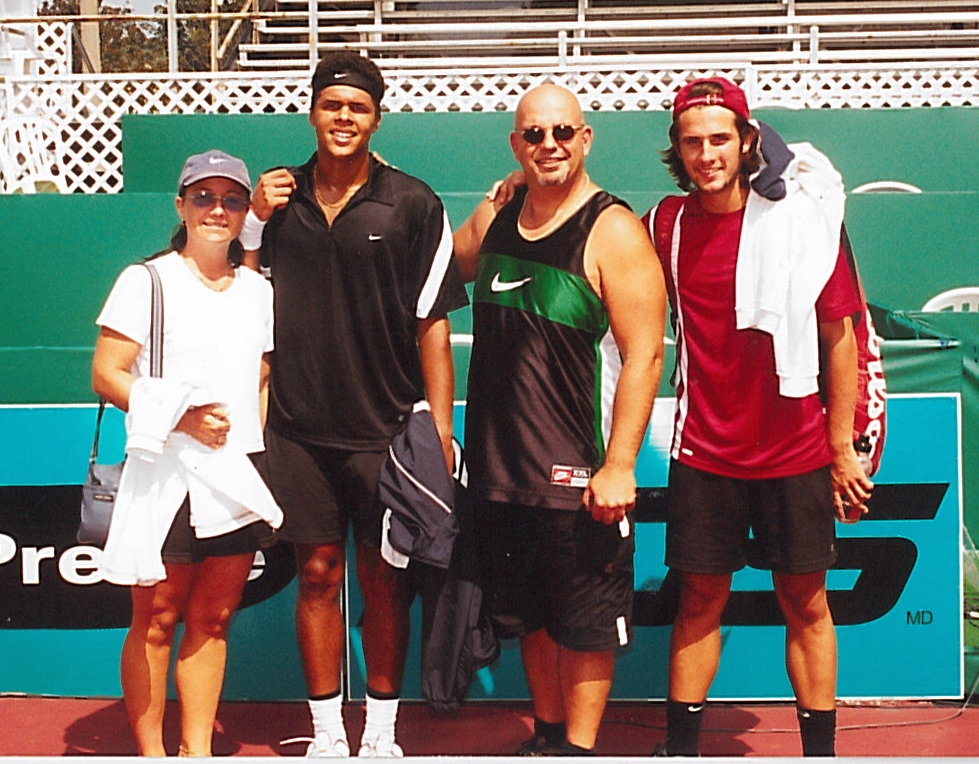 Jo-Wilfried Tsonga, champion in 2002 and now ranked 11th in the world, with his foster family, the Jeté's.